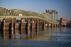 I5 Bridge relecting in the Columbia River. A golden hour image of the I5 bridge reflecting in the water while arching over the Columbia River from Portland Royalty Free Stock Photos