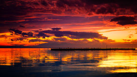 Golden hour. After the rain sunset skies overlooking the docks of a small fishing boat harbor Stock Photography