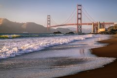 Marshall Beach Waves, Golden Gate Bridge. Golden hour is setting on Marshall Beach with a loverly strong breeze, rolling waves wash rhythmically over the sand stock images