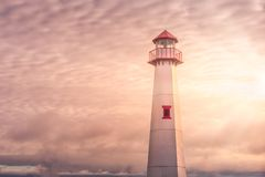 Golden hour shot of Wawatam lighthouse at the harbor of St. Ignace, Michigan in the Straits of Mackinac royalty free stock photo