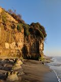Golden Hour Sunset on the Pacific Ocean in Southern California. The golden hour of sunset on the Pacific coast in Encinitas, California with a cliff formation stock photography