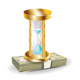 Golden hourglass on money stack Stock Photos