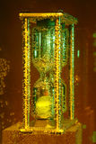 Golden hourglass in water Stock Photography