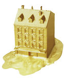 Golden house. Model of a house covered in gold stock photography