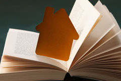 Golden house and book Stock Image