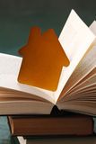 Golden house and book Royalty Free Stock Photo