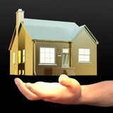 Golden house floating on palm Royalty Free Stock Image