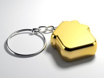 Golden house key chain Royalty Free Stock Photography