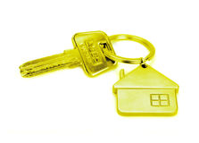 Golden house key isolated Royalty Free Stock Photography