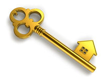 Golden house-shape key Royalty Free Stock Photography