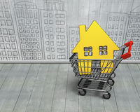 Golden house in shopping cart Royalty Free Stock Image