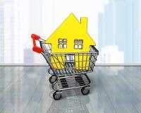 Golden house in shopping cart Stock Photo