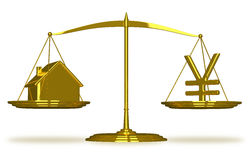 Golden house and yuan sign on scales Royalty Free Stock Photo