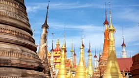 The stupas of Indein shrine, Inle Lake, Myanmar. The golden hti umbrellas on the top of medieval stupas of Inn Thein Buddha image Shrine, famous religious and stock video