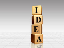 Golden Idea. Idea - golden boxes with black letters over white-grey background Stock Photography