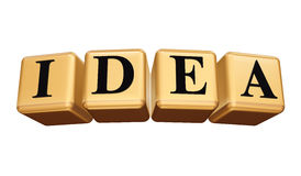 Golden Idea isolated. Idea - golden boxes with black letters over white background isolated Stock Images