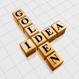 Golden idea like crossword. 3d gold boxes with black letters with text - golden idea, crossword Stock Image