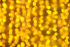 Golden illumination background. Defocused picture of illumination curtain royalty free stock photos