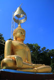 Golden image of Buddha. The golden image of Buddha which have Thai art umbrella over the head Stock Photos