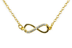 Golden infinity pendant with diamonds Stock Images