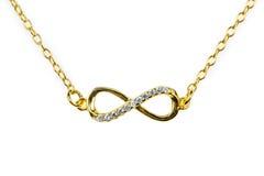 Golden infinity pendant with diamonds Stock Images