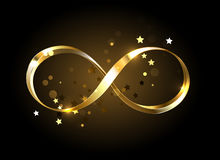 Golden infinity symbol Stock Images