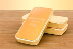 Golden ingots closeup on the wooden background. 3D rendering. Golden ingots closeup on the wooden background. 3D Royalty Free Stock Photography