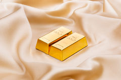 Golden ingots Stock Images