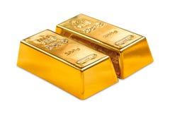 Golden ingots. Two golden ingots on white background Royalty Free Stock Photo