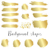 Golden ink borders, brush strokes, stains, banners, blots, splatters. Royalty Free Stock Photo