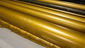 Golden ink printer rollers offset industry stock footage