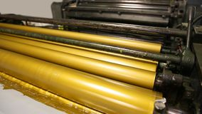 Golden ink printer rollers offset industry stock video footage