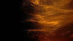 Golden ink in water shooting with camera. Gold drops of paint dropped, reacting, creating abstract cloud formations