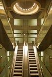 Golden interior escalator in business architecture Royalty Free Stock Photos