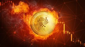 Golden IOTA coin falling in fire flame. Golden IOTA coin in fire flame is falling. Burning crypto currency IOTA falling down, blockchain cryptocurrency market Stock Images