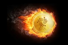 Golden IOTA coin flying in fire flame. Blockchain token grows in price on stock market concept. Burning crypto currency IOTA symbol illustration isolated on Stock Photography