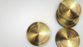 Golden iota coins falling on white background. Animation stock footage