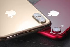 Golden iPhone XS Max and red iPhone XR royalty free stock image