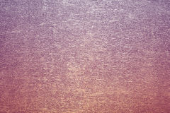 Golden iridescent background. Golden mother-of-pearl background with a shallow texture Stock Images
