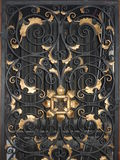 Golden iron gate with ornaments Royalty Free Stock Images