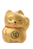 Golden japanese fat cat ceramic on white background. Golden japanese fat lucky cat and wealth ceramic talisman isolated on white background Stock Photos