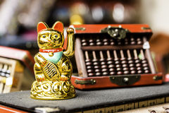 Golden Japanese Lucky Cat, Asia Royalty Free Stock Images