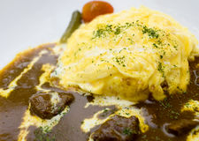 Golden Japanese Omelette Curry rice beef. Golden Japanese Omelette Curry rice with beef Royalty Free Stock Photo