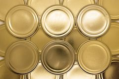 Golden jar lids background stock photography