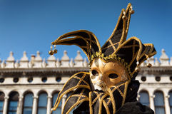 Golden jester mask at Venice Carnival Stock Images