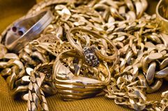 Golden jewelery. Several rings and necklages Stock Image