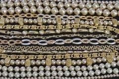 Golden jewelery closeup. Variety of golden jewelery closeup Royalty Free Stock Photography
