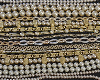 Golden jewelery closeup Royalty Free Stock Photos