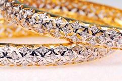 Golden jewellery Stock Photography