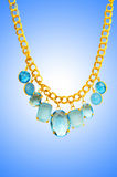 Golden jewellery against gradient Stock Photo
